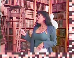 two hot lesbians fucking in the library in front of the camera